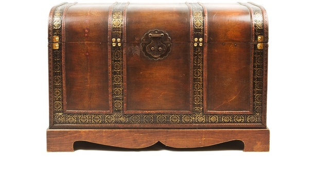 Antique wooden trunk isolated on white