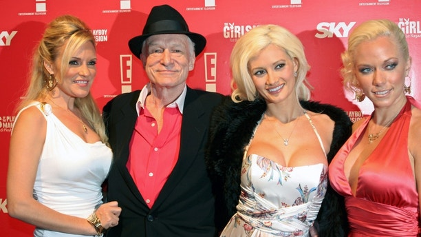 Playboy founder Hugh Hefner (2nd L) celebrates his 80th birthday accompanied by Playmates Bridget Marquardt (L), Holly Madison (2nd R) and Kendra Wilkinson at a party in Rome June 1, 2006. Picture taken June 1, 2006.  REUTERS/Remo Casilli (ITALY) - RTR1E08S