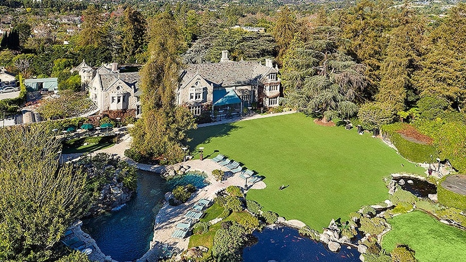 The property is directly across the street from the famed, former Playboy Mansion.
