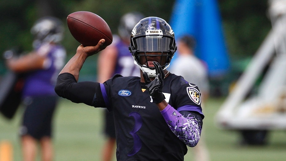 Baltimore Ravens quarterback Robert Griffin III throws a pass during an NFL football training camp practice at the team's headquarters, Friday, July 20, 2018, in Owings Mills, Md. (AP Photo/Patrick Semansky)