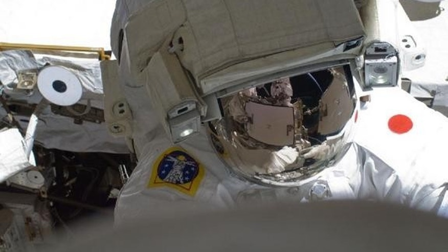 Japan Aerospace Exploration Agency astronaut Akihiko Hoshide and NASA astronaut Sunita Williams (out of frame), performed a spacewalk to upgrade the International Space Station on Aug. 30, 2012.