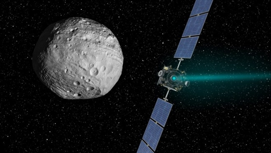 An artist's concept of NASA's Dawn spacecraft and the giant asteroid Vesta. Dawn arrived at Vesta on July 15, 2011 and is set to depart on Sept. 4, 2012.