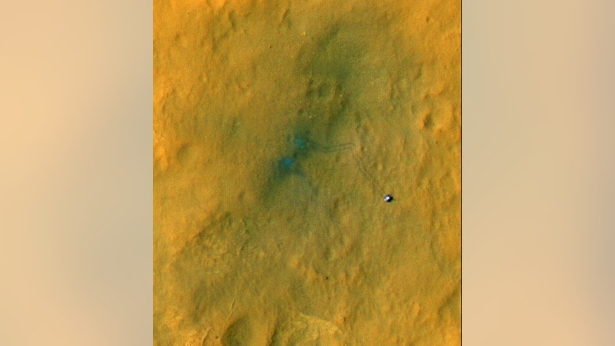 Tracks from the first drives of NASA's Mars rover Curiosity are visible in this image captured by the Mars Reconnaissance Orbiter. The rover is seen where the tracks end. The image's color has been enhanced to show the surface details better. I