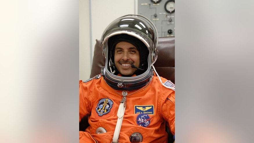 Astronaut José Hernández suits up for flight on space shuttle mission STS-128.