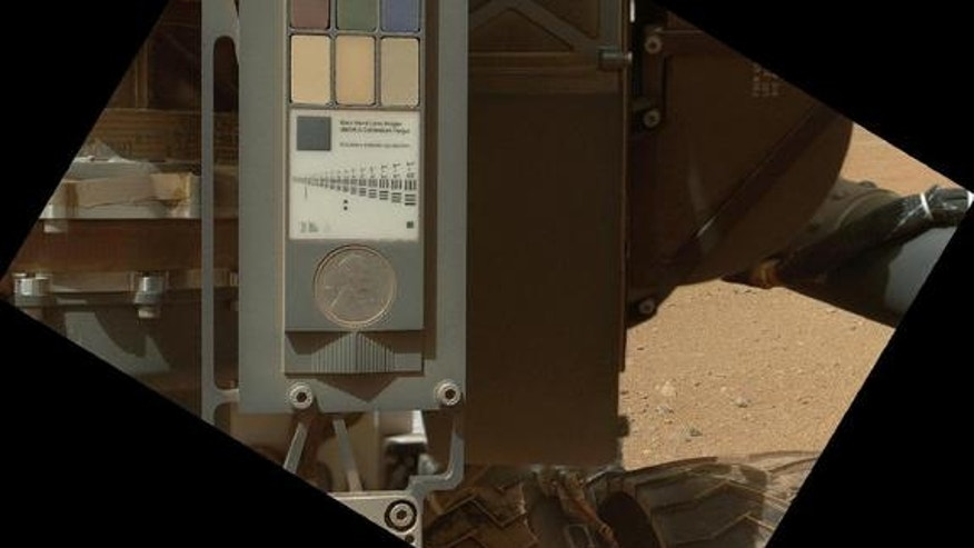 This view of the calibration target for the Mars Hand Lens Imager (MAHLI) aboard NASA's Mars rover Curiosity combines two images taken by that camera during the 34th Martian day, or sol, of Curiosity's work on Mars. This image was taken Sept. 9