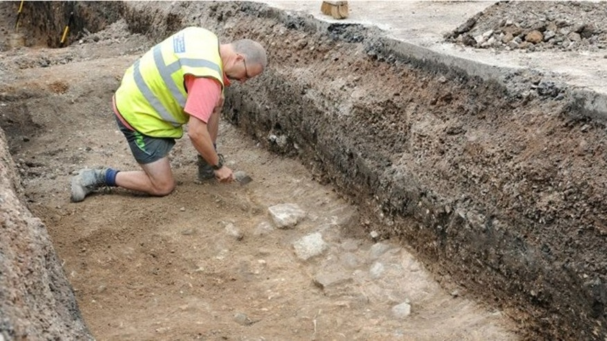 A worker checks one of the trenches in the parking lot where Richard III&#39&#x3b;s remains are believed to lie.