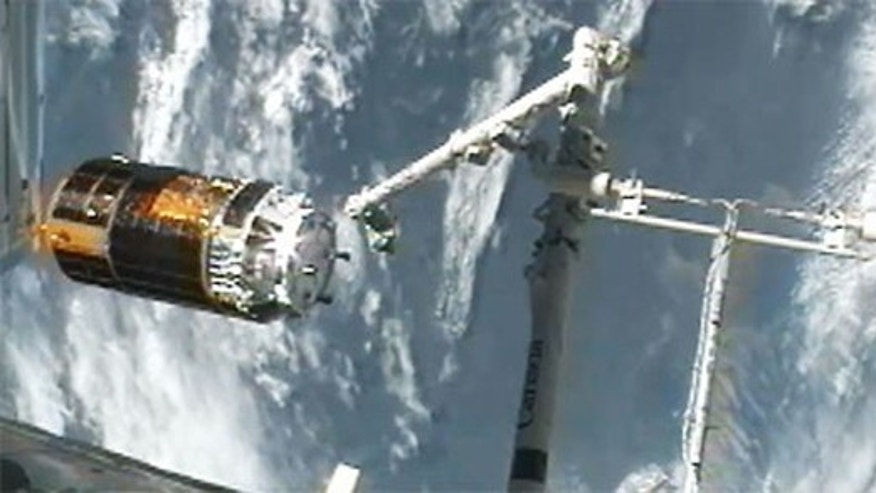 Japan's HTV-3 robotic cargo ship leaves the International Space Station on Sept. 12, 2012, after being released from the station's robotic arm. Astronauts inside the station used the arm to detach the HTV-3 cargo ship from the station and set i