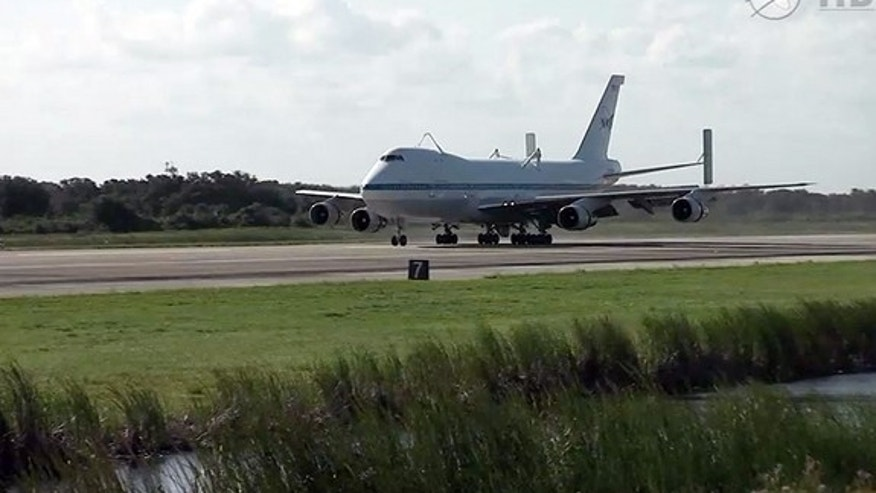 NASA's modified Boeing 747 Shuttle Carrier Aircraft lands at the Kennedy Space Center in Florida, Sept. 11, 2012.