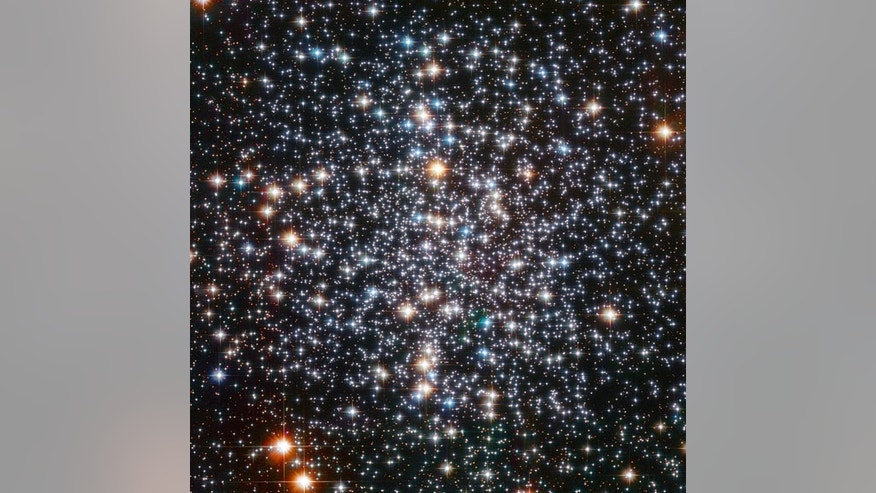 The many stars of the M4 globular cluster blaze like fireballs in this image snapped by the Hubble Space Telescope.