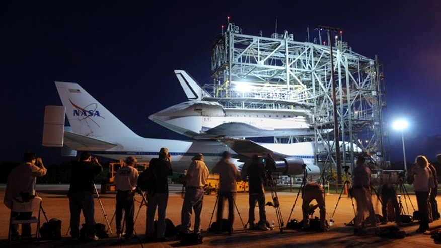 Sept. 16, 2012: The space shuttle Endeavour is prepared for transport on a modified Boeing 747 aircraft.