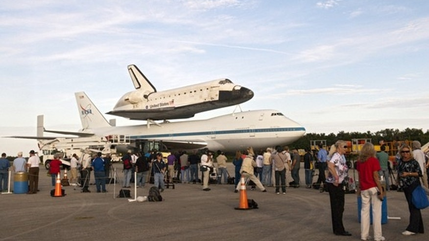 Media representatives are given the opportunity to photograph space shuttle Endeavour, secured atop NASA's Shuttle Carrier Aircraft or SCA, at the Shuttle Landing Facility at NASA's Kennedy Space Center in Florida on Sunday (Sept. 16, 2012).  T