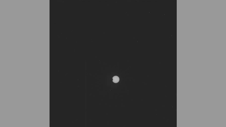 NASA's Mars rover Curiosity snapped this picture of the Martian moon Phobos transiting the sun on Sept. 13, 2012.