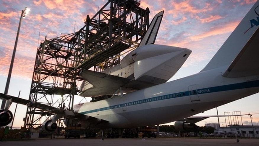 Space shuttle Endeavour is seen at the Kennedy Space Center in Florida atop NASA's modified Boeing 747 Shuttle Carrier Aircraft (SCA) at sunrise on Sunday, Sept. 16, 2012.