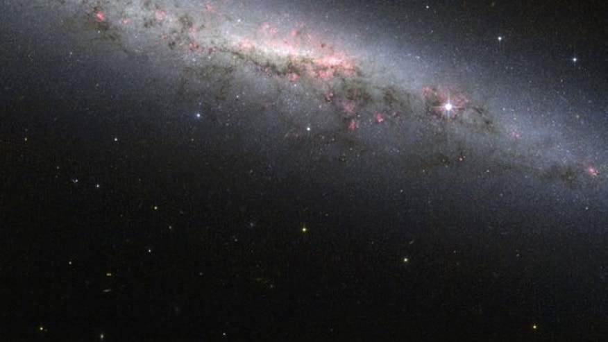 This shot from the Hubble Space Telescope shows an edge-on view of the star-forming galaxy NGC 7090, which is located about 30 million light-years from Earth.