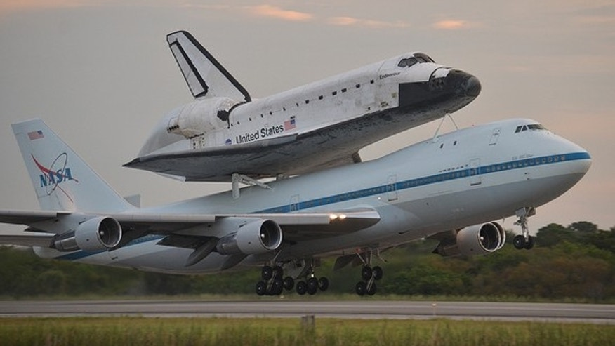 Space shuttle Endeavour, atop its Shuttle Carrier Aircraft, takes off on NASA's last-ever ferry flight from the Kennedy Space Center in Florida on Sept. 19, 2012. Endeavour is headed for Los Angeles, Calif., to be put on public display at the C
