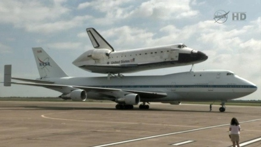 The Shuttle Carrier Aircraft carrying shuttle Endeavour to Los Angeles comes to a stop on the runway at Ellington Field, Houston, TX, on September 19, 2012.