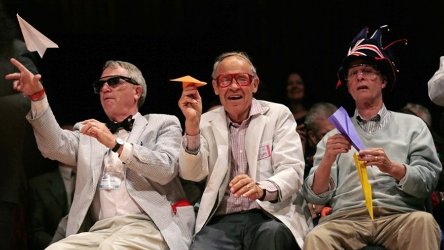Sept. 20, 2012: Harvard University Clowes Professor of Science Robert Kirshner, left, along with Nobel laureates Dudley Herschbach, center, and Rich Roberts, fire paper airplanes back at the audience during a performance at the Ig Nobel Prize ceremony.