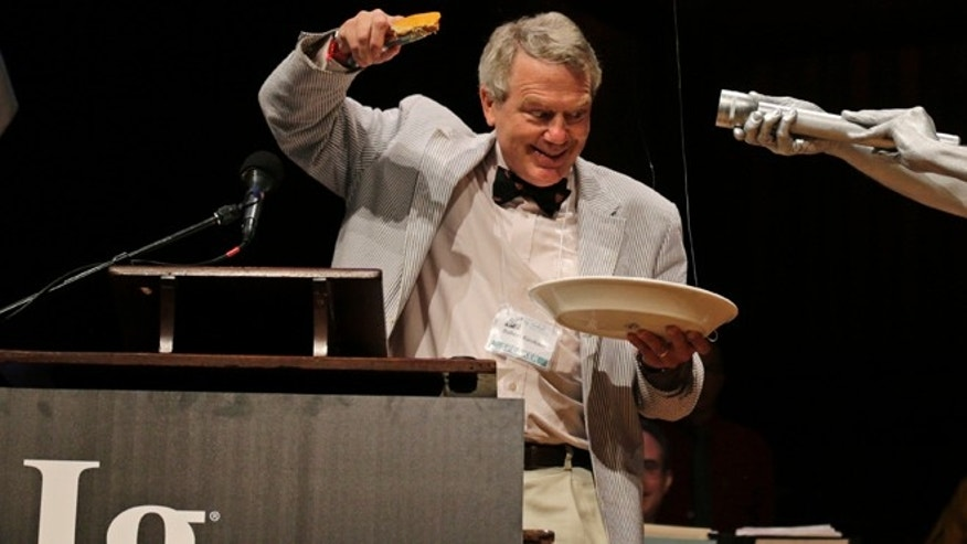 Sept. 20, 2012: 2011 Nobel Prize laureate for Physics Robert Kirshner holds up a piece of pie while explaining a pie chart about the universe, shortly before eating it.