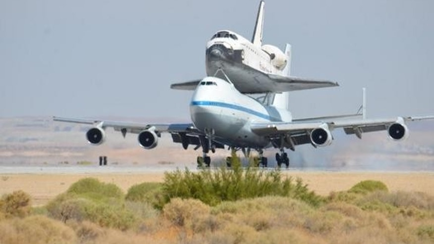 NASA's Space shuttle Endeavour, riding piggyback atop a Shuttle Carrier Aircraft, lands at NASA's Dryden Flight Research Facility in Southern California on Sept. 20, 2012, during the final shuttle ferry flight. Endeavour is headed to Los Angele