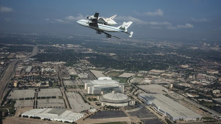 Space Shuttle Endeavour is ferried by NASA's Shuttle Carrier Aircraft (SCA) over Houston, Texas on September 19, 2012. NASA pilots Jeff Moultrie and Bill Rieke are at the controls of the Shuttle Carrier Aircraft. Photo taken by NASA photographe