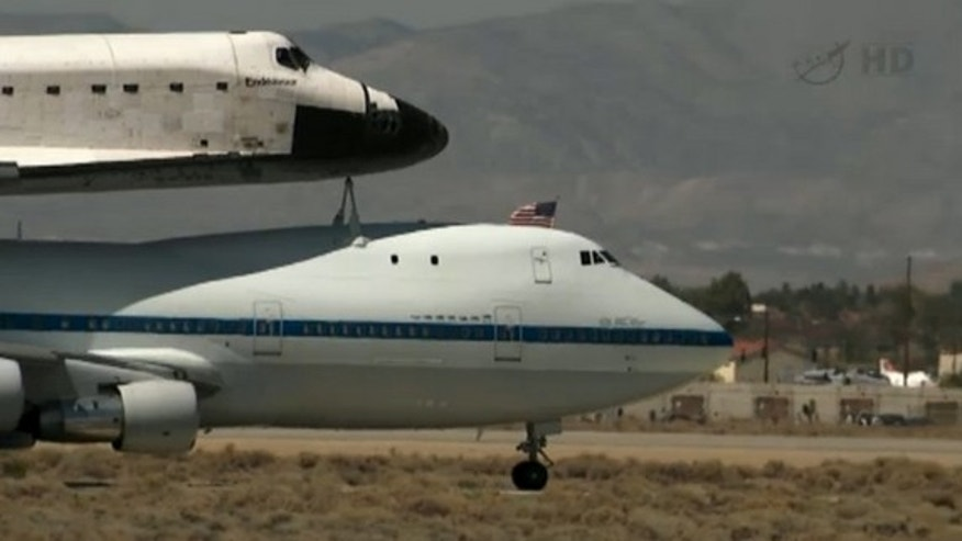 A close-up of NASA's space shuttle Endeavour riding atop its Shuttle Carrier Aircraft just after landing at NASA's Dryden Flight Research Facility near Edwards Air Force Base in Southern California on Sept. 20, 2012. Endeavour is headed to its