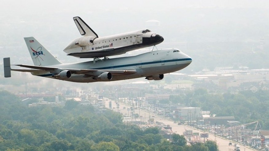 Sept. 19, 2012: The space shuttle Endeavour, carried atop NASA's 747 Shuttle Carrier Aircraft, passes over neighborhoods near Hobby Airport during a flyover on Wednesday.
