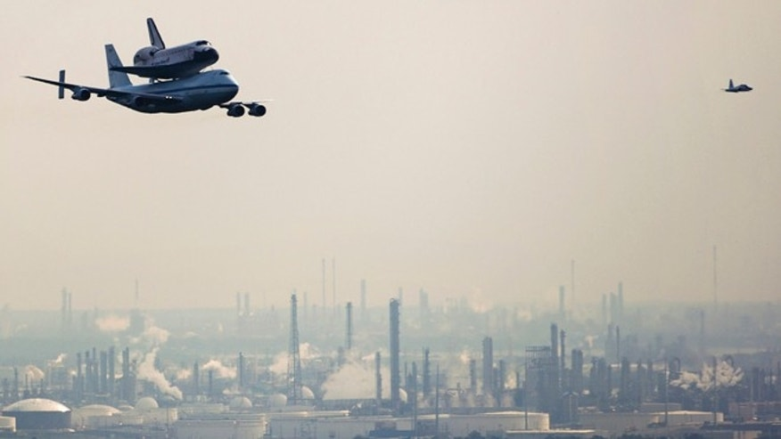 Sept. 19, 2012: The space shuttle Endeavour, carried atop NASA's 747 Shuttle Carrier Aircraft, passes over petrochemical facilities on the Houston Ship Channel during a flyover.