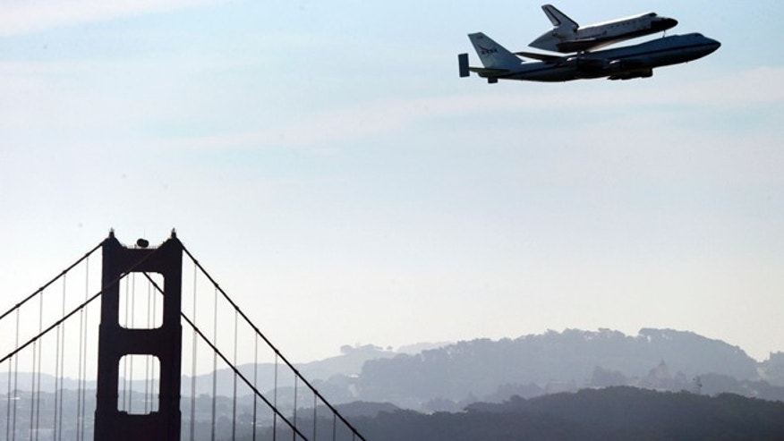 Sept. 21, 2012: Space Shuttle Endeavour mounted on NASA's Shuttle Carrier Aircraft, passes over the Golden Gate Bridge in San Francisco during its final trek across the country.