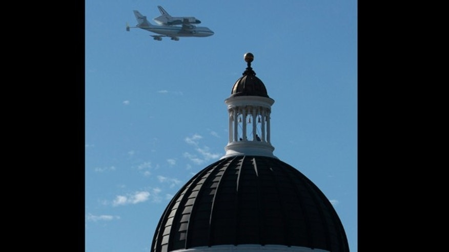 Sept. 21, 2012: The space shuttle Endeavour passes over the California state Capitol in Sacramento, Calif.