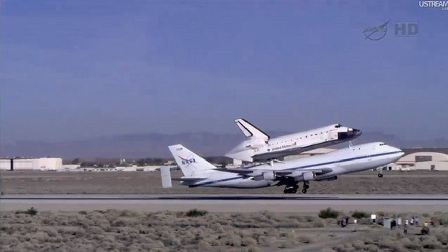 The Shuttle Carrier Aircraft takes off with shuttle Endeavour on its back from Edwards Air Force Base, California, on September 21, 2012.