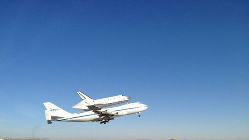 Space shuttle Endeavour takes off from Edwards Air Force Base near the Dryden Flight Research Facility in Southern California for its final ferry flight, a sightseeing trip over California, before arriving at its new museum home in Los Angeles