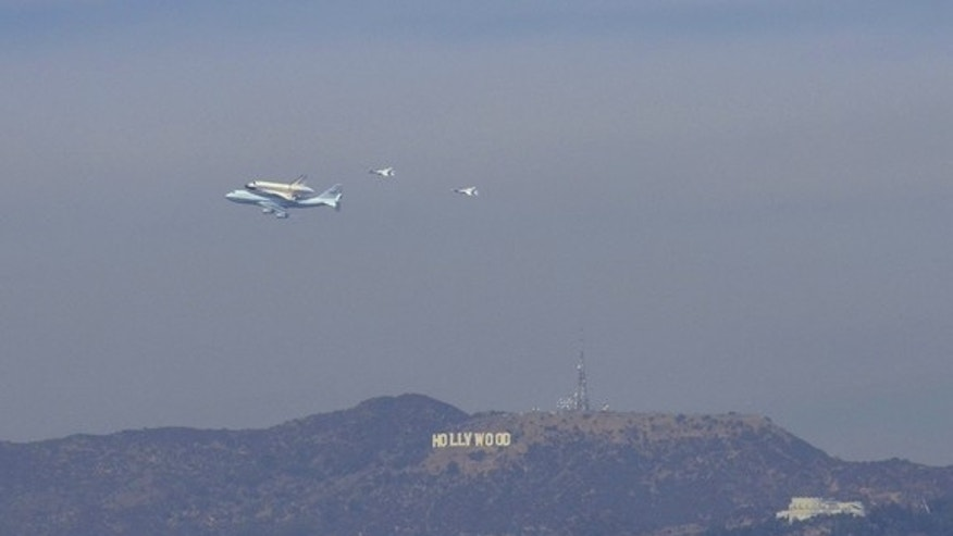 SPACE.com reader Tom Bleicher sent in this photo of shuttle Endeavour flying over Los Angeles with the iconic Hollywood sign in the background, September 21, 2012.