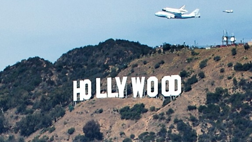 Photographer Olivia Hemaratanatorn captured this view of space shuttle Endeavour soaring over the famed Hollywood sign during its low flyover of Los Angeles on Sept. 21, 2012. Endeavour landed at Los Angeles International Airport and will ultim