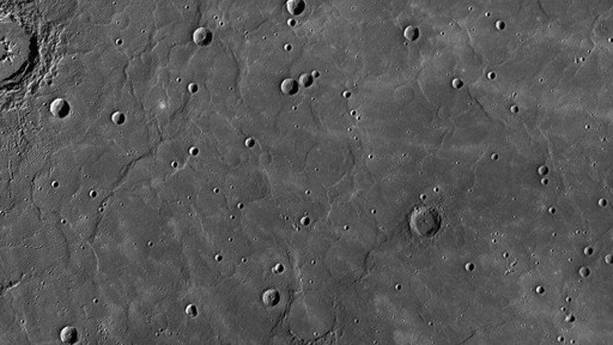 "This view from NASA's Messenger spacecraft orbiting Mercury shows a region of smooth, volcanic plains that have been heavily modified by tectonic structures termed ""wrinkle ridges,"" low, sinuous features that form when lavas cool and subside, c"