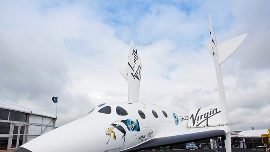 A full-size replica of the Virgin Galactic Spaceship Two sits at the Farnborough International Airshow, Hampshire, England. The image was taken July 9, 2012.