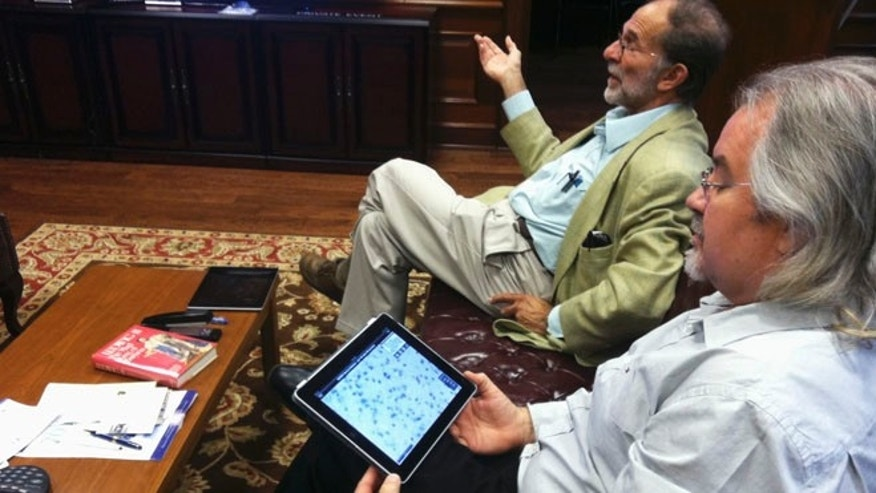Sept. 24, 2012: Dr. Phillip Epstein, left, and Steve Landers of the National Museum of Health and Medicine Chicago talk about a new iPad app that allows users to see Albert Einstein's brain as if they were looking through a microscope.