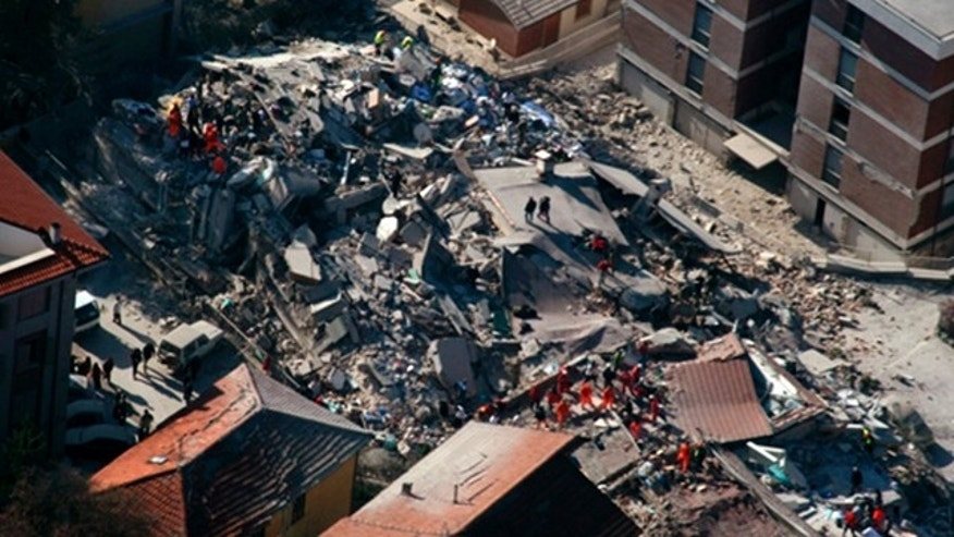 April 6, 2009: An aerial photo provided by the Italian Police shows the debris of a collapsed building in an area near L'Aquila, central Italy, after a powerful earthquake shook central Italy.