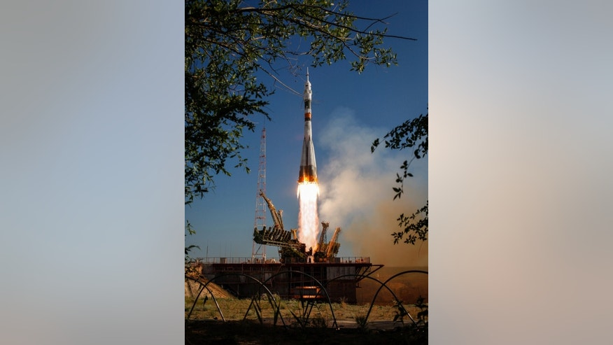 The Soyuz TMA-04M rocket launches from the Baikonur Cosmodrome in Kazakhstan on Tuesday, May 15, 2012 carrying Expedition 31 Soyuz Commander Gennady Padalka, NASA Flight Engineer Joseph Acaba and Flight Engineer Sergei Revin to the Internationa