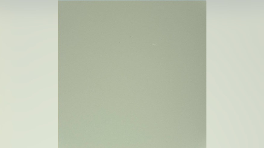 NASA's Mars rover Curiosity snapped this photo of the largest Martian moon Phobos during a Mars sky observing session. Phobos is Mars' largest moon, but only 14 miles across. Image released Sept. 26, 2012.