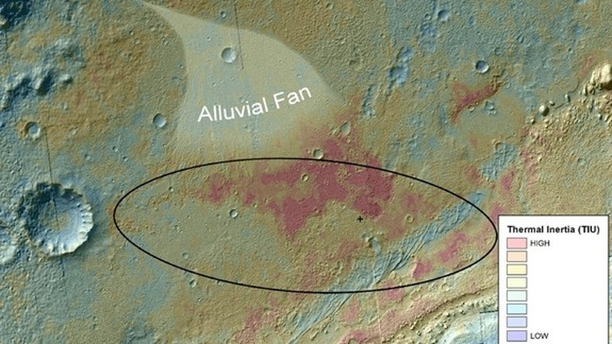 This false-color map shows the area within Gale Crater on Mars, where NASA's Curiosity rover landed on Aug. 5, 2012 PDT (Aug. 6, 2012 EDT). It merges topographic data with thermal inertia data that record the ability of the surface to hold onto