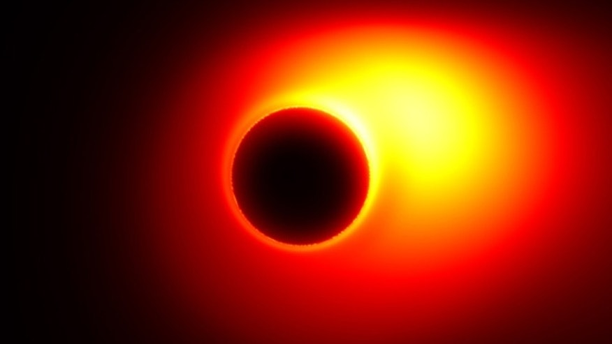 This image from a simulation shows an energy jet launched from a spinning black hole surrounded by a disk of accreting material. The central black hole 'shadow' due to extreme light bending is apparent in this simulation.