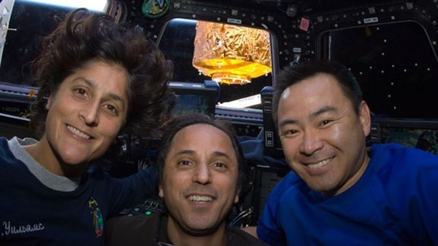 NASA astronauts Sunita Williams (left) and Joe Acaba (center), along with Japanese astronaut Aki Hoshide, float inside the International Space Station's cupola in August 2012.