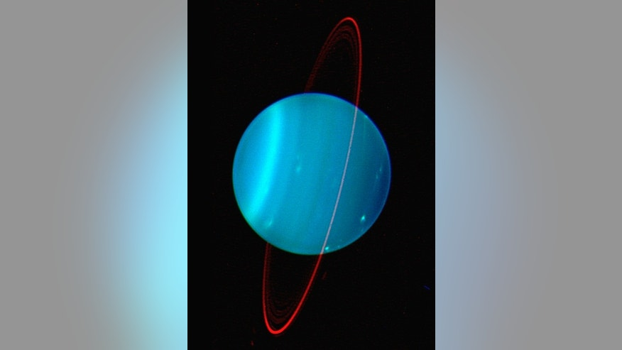 The two sides of the planet Uranus, as viewed in this composite image, by the Keck Telescope at near infrared wavelengths. These new images of the seventh planet from the sun promise to help scientists unravel the mysteries of the weather on Uranus.