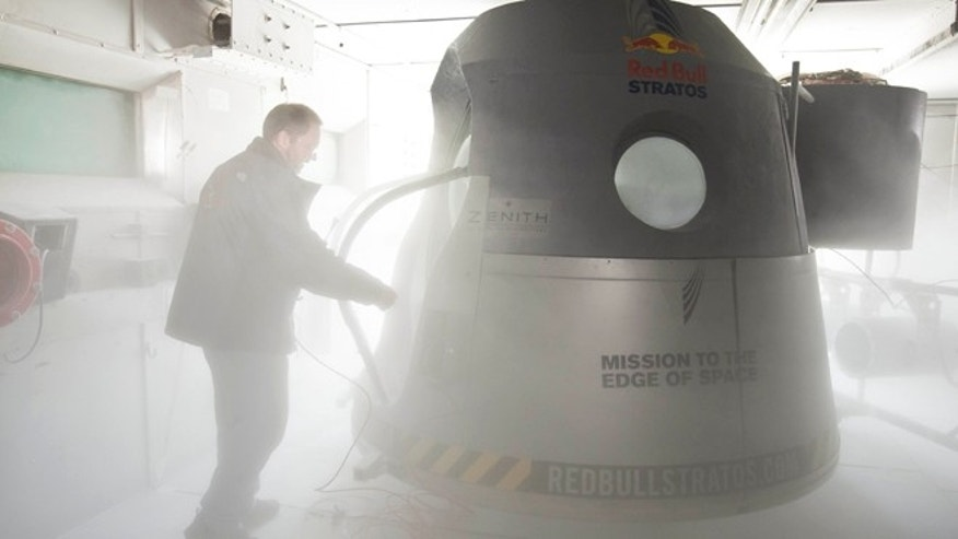 Sept. 24, 2012: A crew member adjusts the space capsule of the Red Bull Stratos mission in the pressure chamber at Brooks Air Force Base in San Antonio, Texas.