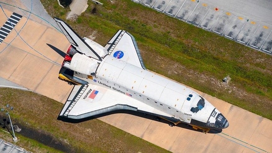 Space shuttle Atlantis, seen here on the move in May 2011, will depart on Nov. 2, 2012 on its final transport to NASA's Kennedy Space Center Visitor Complex.