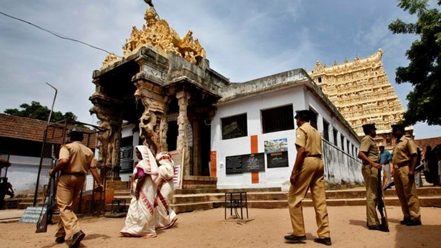 July 5, 2011: Policemen change guard outside the 16th-century Sree Padmanabhaswamy temple, where a vast treasure trove has turned the temple into one of the wealthiest religious institutions in India.