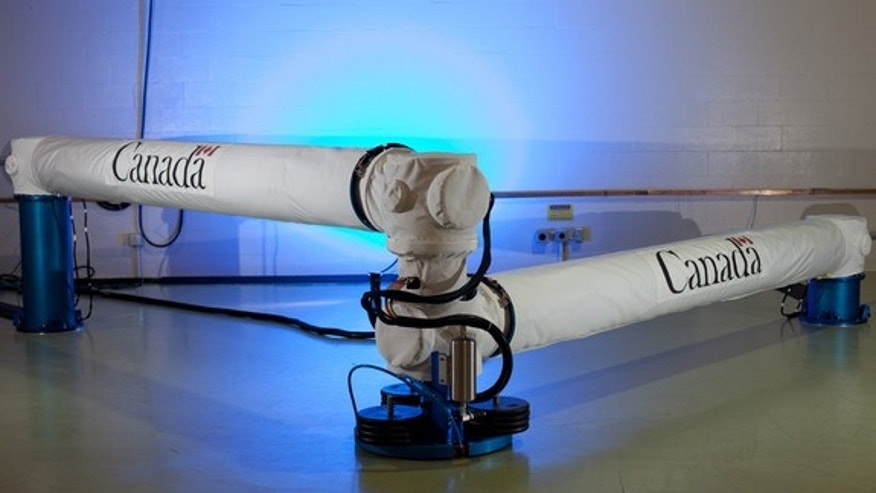This nearly 50-foot prototype of the Next-Generation Canadarm can compact for transport in a small spacecraft.