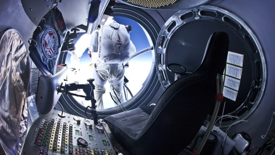 July 25, 2012: Pilot Felix Baumgartner of Austria steps out from the capsule during the second manned test flight for Red Bull Stratos in Roswell, New Mexico.