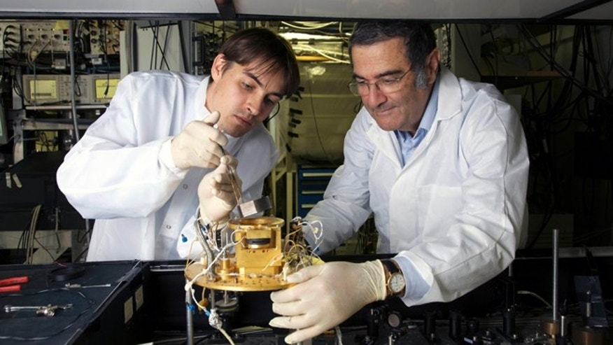 French physician Serge Haroche, right, and his aide Igor Dotsenko in Paris in 2009. Haroche and U.S David wineland share the 2012 Nobel Prize in physics Tuesday Oct. 9, 2012.