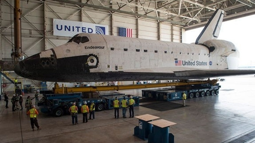 Space shuttle Endeavour is seen atop the Over Land Transporter in a hangar at Los Angeles International Airport.